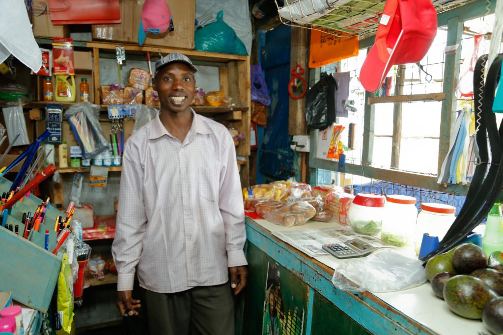 John Rono runs a small-scale shop in western Kenya. He also farms to supplement his income. Photo: World Agroforestry