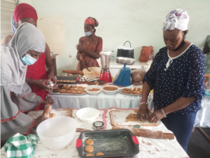 Practical session on groundnut recipes by participants. Photo Credit: Desmond S. Adogoba (CSIR-SARI)
